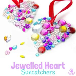 JEWELLED HEART SUNCATCHERS are so pretty! This is an easy recycled craft for kids and they make lovely gifts too. A great kids craft for Valentine's Day, Mother's Day and Summer. #valentine #valentinesday #valentinesdaycraft #valentinecraft #valentinescrafts #valentinecrafts #valentinesdayforkids #heart #love #heartcrafts #upcycledcraft #recycledcraft #suncatchers #suncatchercrafts #kidsart #ECE #kidscrafts #kidscraft #kidscrafts101 #craftsforkids #preschool #preK #earlyyears
