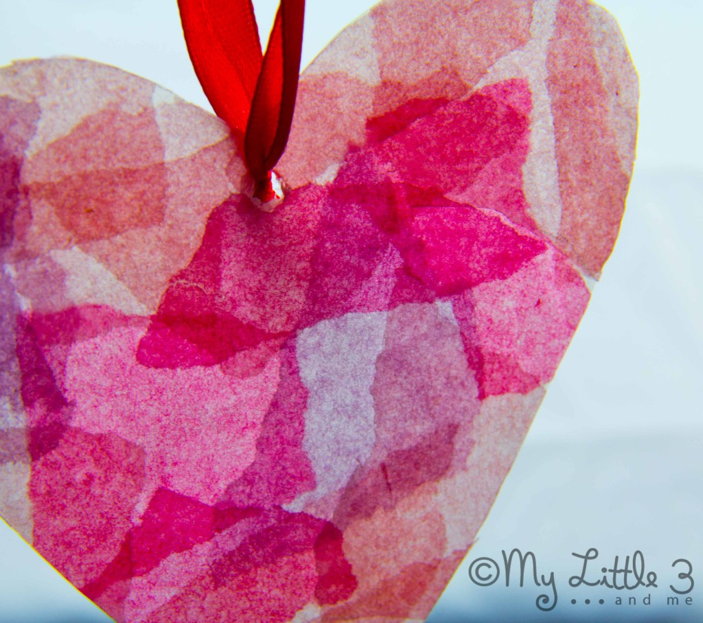 Make gorgeous Stained Glass Hearts from up-cycled milk jugs. A great Valentine's Day craft for kids.