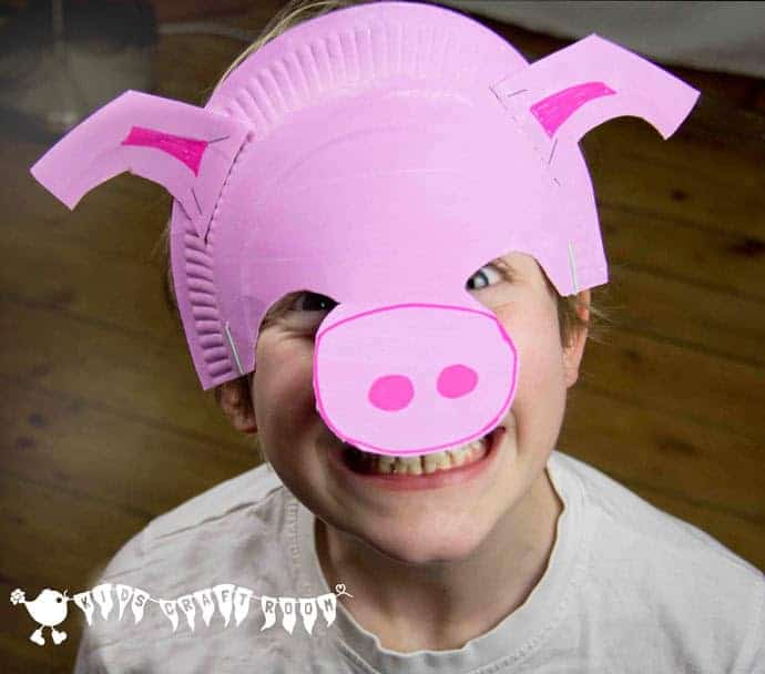 Make a paper plate pig mask. A fun animal craft to promote imaginative play.