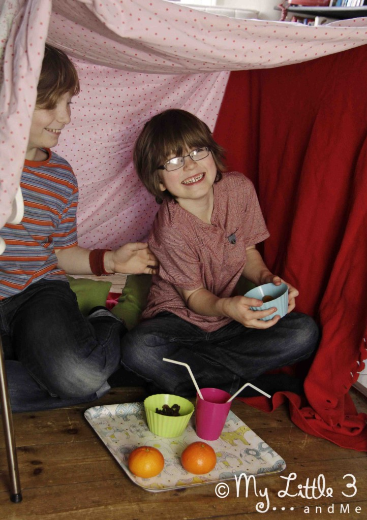 Here's another really simple DEN made by hanging sheets and blankets over 4 chairs.A great place for a tickle and a picnic!