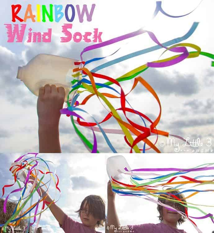A bright and colourful rainbow windsock craft for kids. Great for outside play and for inspiring physical movement and self expression. A fun kids craft for all ages. #rainbows #windsocks #sensoryplay #sensory #sensoryactivities #outsideplay #play #playideas #rainbowcrafts #stpatricksday #preschool #prek #motorskills