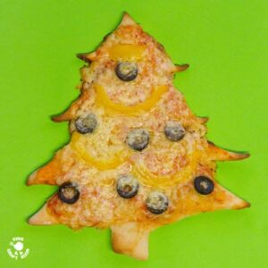 CHRISTMAS TREE PIZZA - the perfect Christmas recipe for cooking with kids. #christmas #christmasecipe #cookingwithkids #christmasideas #christmasideasforkids #pizza #pizzarecipe #kidsactiviies #kidsrecipes #kidscraftroom