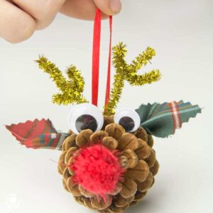 Do you love all things Rudolf? Our homemade Pinecone Reindeer Ornaments are so easy to do and just too cute for words! A fun Christmas reindeer craft for kids. #reindeer #rudolf #christmas #christmascrafts #christmasornaments #ornaments #kidscrafts #pinecones #pineconecrafts #naturecrafts #kidscraftroom