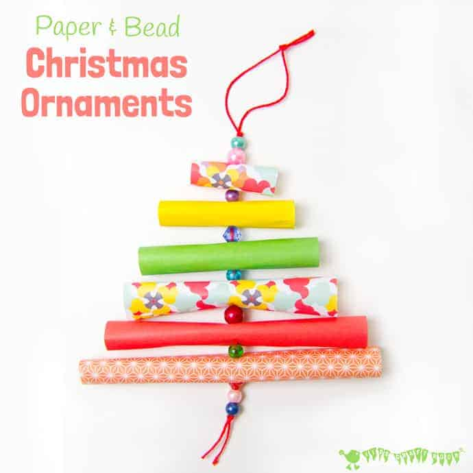 CHRISTMAS TREE PAPER ORNAMENTS - Have fun with paper & beads making adorable homemade Christmas ornaments in the shape of Christmas trees. Pretty enough for grown-ups, simple enough for kids! #christmas #christmascrafts #christmasideas #christmascraftsforkids #christmastree #papercrafts #paper #kidscrafts