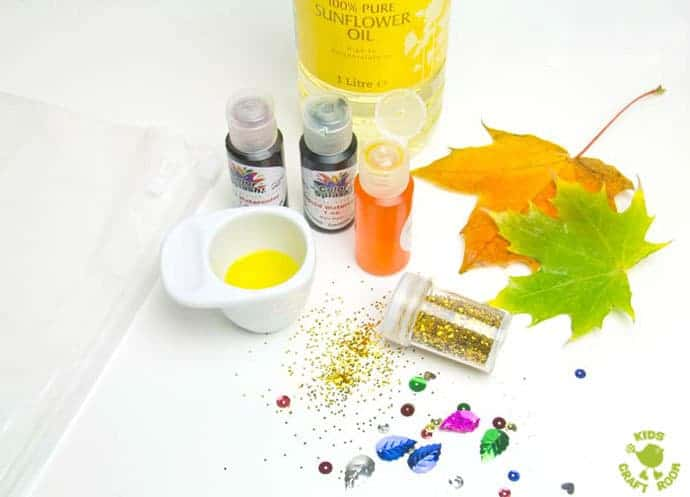 MAKING LEAF SENSORY BAGS - a fantastic mess free Autumn sensory play activity for kids. Children will love to explore this Fall activity that engages the senses.