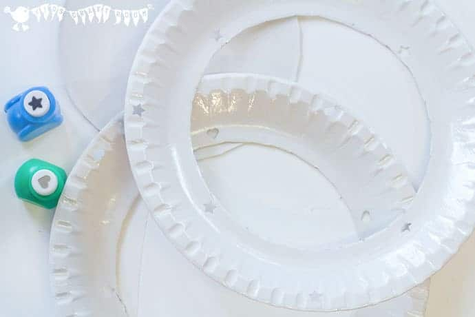 Making paper Plate Webs - Handprint Spiders In Webs are easy & frugal to make and a super way to build fine motor threading skills. A fun spider craft for Halloween & all year round.