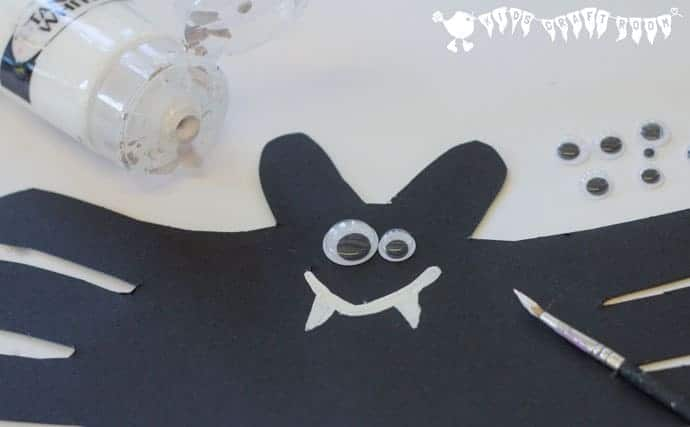 adding-features-to-Halloween-bat-handprint-craft