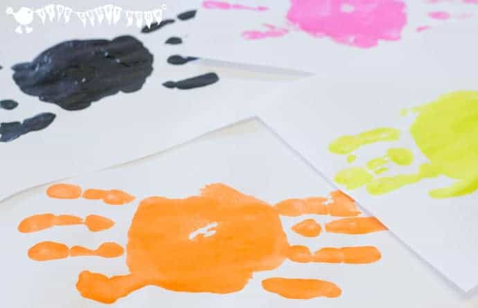 Making Handprint Spiders- Handprint Spiders In Webs are easy & frugal to make and a super way to build fine motor threading skills. A fun spider craft for Halloween & all year round.