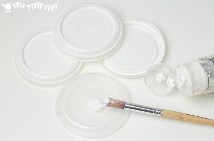 Painting-Lids-for-Snowman-Ornaments