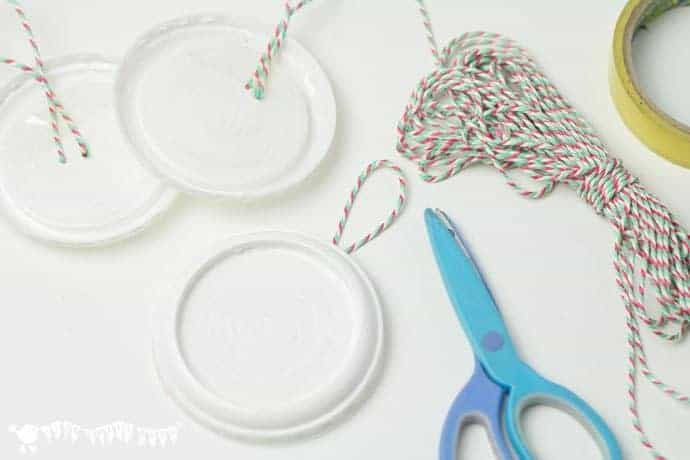 adding-thread-for-hanging-snowman-ornaments