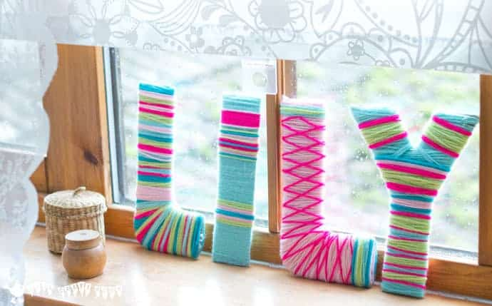 Kids and grown-ups will love this Yarn Wrapped DIY Wall Letter Craft. A cheap DIY hack to make bright wall letter displays for around the home.