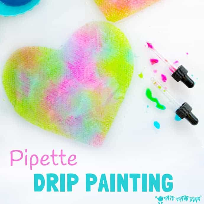 PIPETTE DRIP PAINTING HEARTS is a fun open ended process art for kids that develops fine motor skills, and explores colour mixing and pattern making.