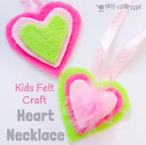 HEART NECKLACES are cute, colourful and no-sew! This kids felt craft is a great way for children to make homemade jewellery for themselves or as cute gifts. A lovely Mother's Day craft or Valentine's Day Craft for kids. #valentine #valentinesday #valentinescraft #valentinecraft #valentinescrafts #valentinecrafts #valentinesdayforkids #heart #love #heartcrafts #sewingforkids #homemadejewllery #necklace #DIYnecklace #feltcrafts #kidscrafts #craftsforkids #kidscraftroom #craftideasforkids