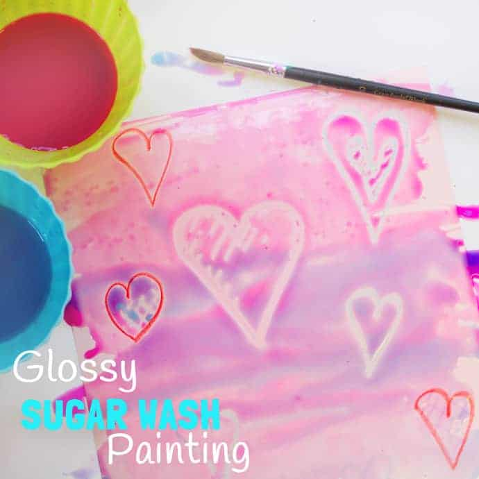 WAX RESIST SUGAR WASH PAINTING is a special and unusual painting activity for kids. It's colourful, glossy and finger licking good fun! Kids will love it! #valentine #valentinesday #valentinescraft #valentinecraft #valentinescrafts #valentinecrafts #valentinesdayforkids #heart #love #kidsart #processart #painting #paintingideas #kidspainting #paintingforkids #heartcrafts #kidscrafts #craftsforkids #kidsactivities #activitiesforkids #preschool #ECE