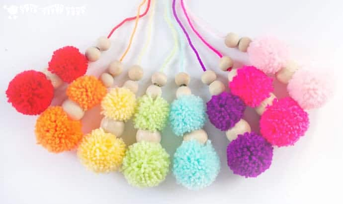 DIY RAINBOW POM POM MOBILE - brighten up your baby nursery, kids bedrooms or add a splash of colour to your living area with this cute and easy craft. A super way to use up yarn scraps.