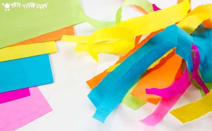tearing-paper-strips-to-make-an-easter-egg-suncatcher-craft-with-tissue-paper