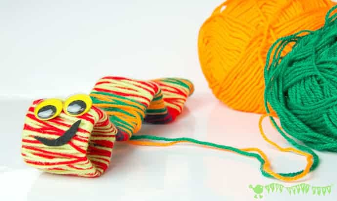 This yarn wrapped caterpillar and butterfly craft is perfect for following up a real life nature hunt. A simple preschool craft that builds fine motor skills and supports learning.