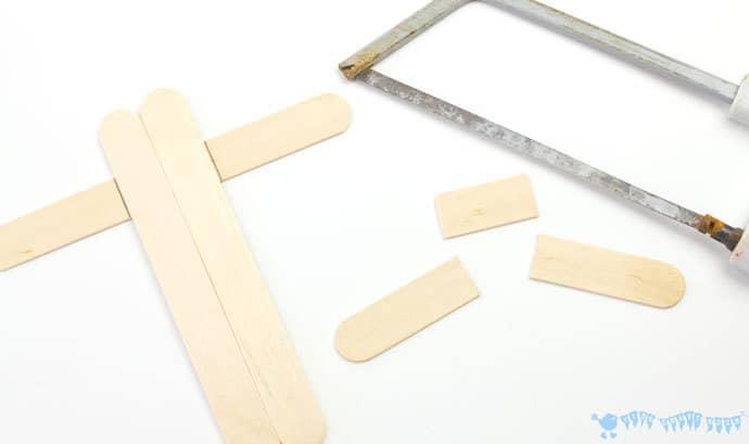 Cutting-popsicle-sticks-to-make-a-mix-n-match-snake-craft