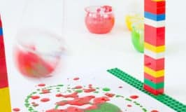 Swing, spin, splatter! We LOVE this LEGO® Pendulum Painting activity for kids and know that you will too! It's one of over 100 ways to create, play and learn with LEGO.