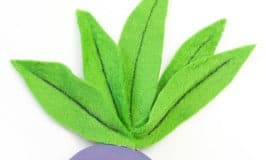 Pokemon craft for kids - a cute pocket sized Oddish craft you can actually play with! A great pebble Pokemon DIY for Pokemon Go fans.