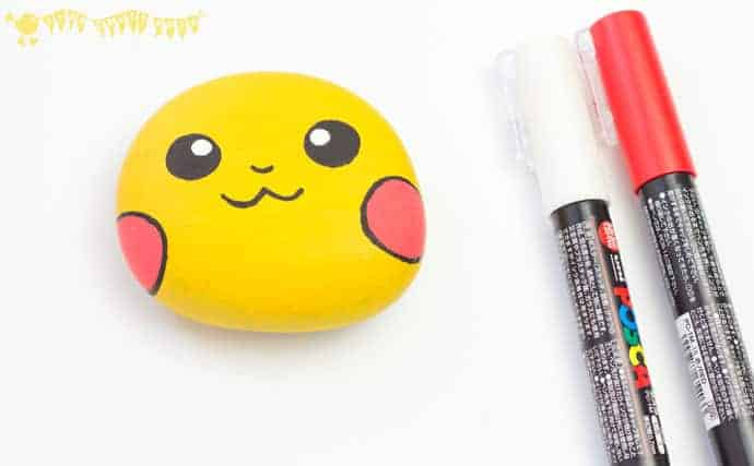 adding-detail-to-Pikachu-craft-a-cute-pebble-Pokemon-DIY