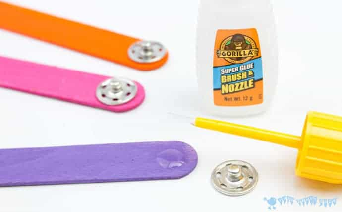 glueing-poppers-to-a-mix-n-match-articulated-snake-craft