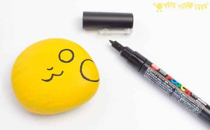 starting-to-add-features-to-Pikachu-craft-a-cute-pebble-Pokemon-DIY