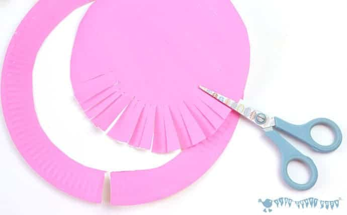 cutting-smaller-paper-plates-to-make-paper-plate-rosettes-grandparents-day-craft