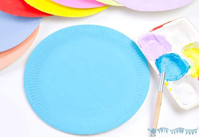 painting-paper-plates-to-make-paper-plate-rosettes-grandparents-day-craft
