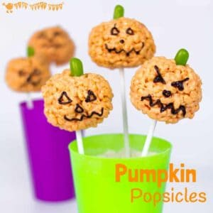 PUMPKIN POPSICLES RICE KRISPIE TREATS - Kids will love making these cute Halloween treats. They are quick and easy, great for some last minute tasty fun!