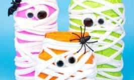 This Halloween make spooky Neon Mason Jar Mummies. These colourful mummies look great day and night! Fill them with candy or tea lights for Mummy Lanterns.