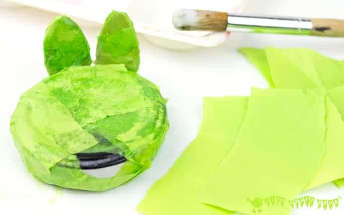 Paper-mache croaking frog craft.
