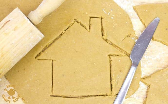 This easy gingerbread house recipe is great fun for the whole family. Forget the frustrations of 3D houses that fall down and make pretty 2D gingerbread houses instead. Just as pretty and delicious but without all the hassle! These cute gingerbread houses can be hung on the Christmas tree and given as gifts too-step 1