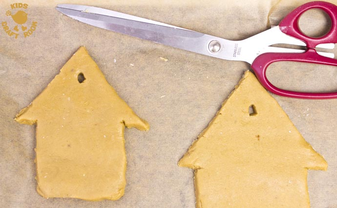 This easy gingerbread house recipe is great fun for the whole family. Forget the frustrations of 3D houses that fall down and make pretty 2D gingerbread houses instead. Just as pretty and delicious but without all the hassle! These cute gingerbread houses can be hung on the Christmas tree and given as gifts too-step 2