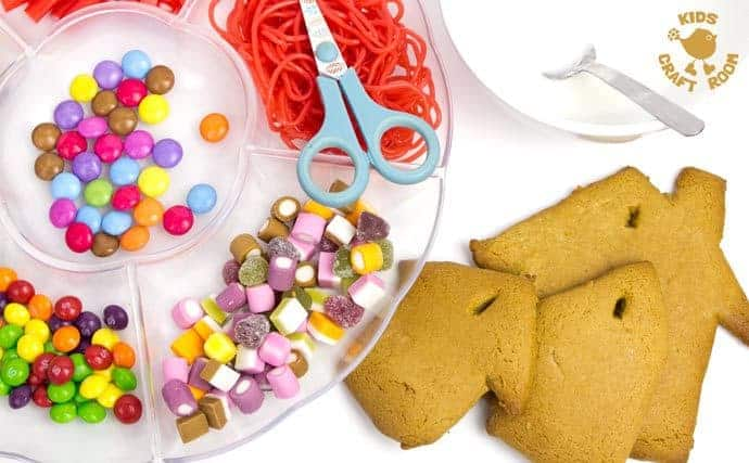 This easy gingerbread house recipe is great fun for the whole family. Forget the frustrations of 3D houses that fall down and make pretty 2D gingerbread houses instead. Just as pretty and delicious but without all the hassle! These cute gingerbread houses can be hung on the Christmas tree and given as gifts too-step 4