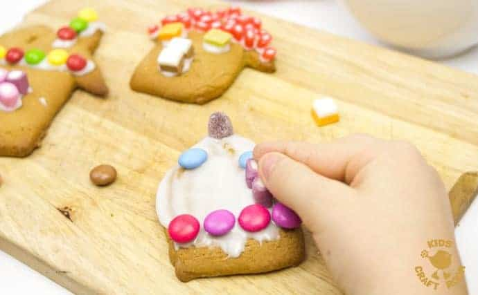 This easy gingerbread house recipe is great fun for the whole family. Forget the frustrations of 3D houses that fall down and make pretty 2D gingerbread houses instead. Just as pretty and delicious but without all the hassle! These cute gingerbread houses can be hung on the Christmas tree and given as gifts too - step-5