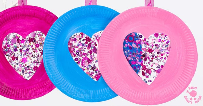 This PAPER PLATE HEART SUNCATCHER CRAFT is gorgeous! A simple heart craft perfect for Valentine's Day, Mother's Day and Summer. Great for all ages from toddlers to tweens. #valentine #valentinesday #valentinescraft #valentinecraft #valentinescrafts #valentinecrafts #valentinesdayforkids #heart #love #paperplate #paperplatecrafts #kidscrafts #heartcrafts #craftsforkids #kidscraftroom