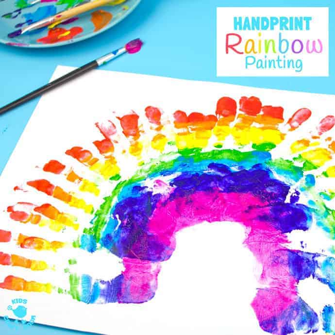 handprint rainbow painting is a fun sensory art experience for kids get hands - Colour Painting For Kids
