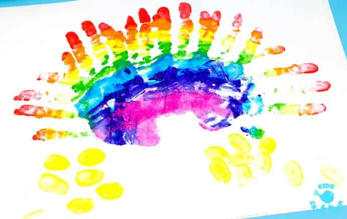 "HANDPRINT RAINBOW PAINTING is a fun sensory art experience for kids. Get ""hands-on"" with paints and explore colour mixing and blending! A creative painting idea for St Patrick's Day and weather study themes."