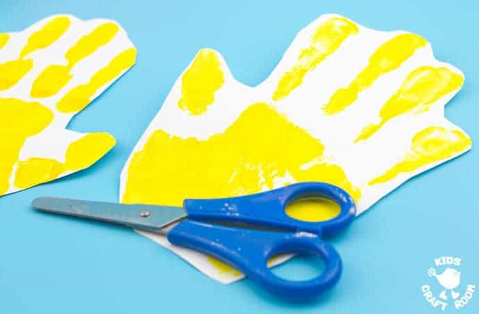 Handprint Chick Puppet Craft step 1 - Handprint Chick Puppets are a great Spring craft or Easter craft for kids. This chick craft looks super cute and kids can actually play with them too! Such a fun handprint craft to encourage dramatic play and story telling.