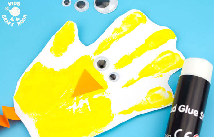Handprint Chick Puppet Craft step 5 - Handprint Chick Puppets are a great Spring craft or Easter craft for kids. This chick craft looks super cute and kids can actually play with them too! Such a fun handprint craft to encourage dramatic play and story telling.
