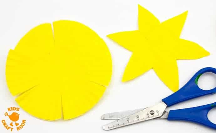 POP UP DAFFODIL CRAFT Step 2 - A simple Spring craft perfect for Easter or Mother's Day too. This cupcake liner and paper plate flower craft lets kids pretend to grow their own daffodils again and again!