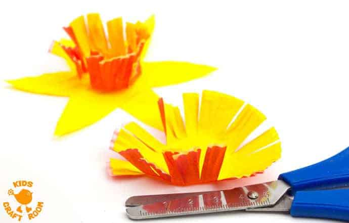 POP UP DAFFODIL CRAFT Step 5 - A simple Spring craft perfect for Easter or Mother's Day too. This cupcake liner and paper plate flower craft lets kids pretend to grow their own daffodils again and again!