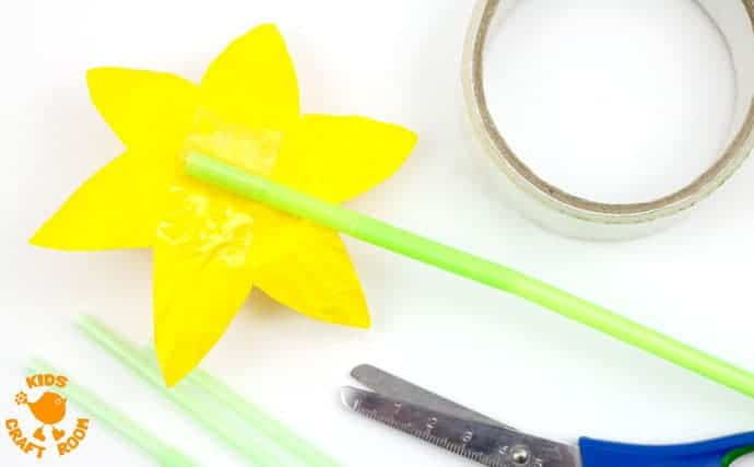 POP UP DAFFODIL CRAFT Step 6 - A simple Spring craft perfect for Easter or Mother's Day too. This cupcake liner and paper plate flower craft lets kids pretend to grow their own daffodils again and again!