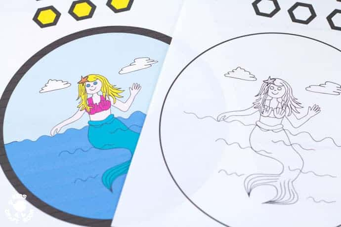 Free Pirate and Mermaid Scene Printables - PAPER PLATE PORTHOLE CRAFT - a fantastic ocean craft for kids that love pirates and mermaids. This interactive moving paper plate craft is so fun! Wiggle the handle to make the ocean scene bob up and down like real waves! An exciting Summer craft for kids. (Free black & white and full colour printables available.)
