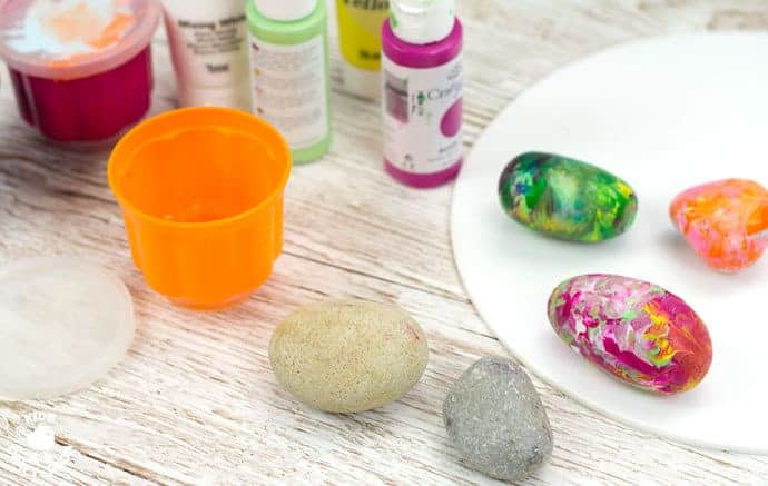 Step 1- SHAKE PAINTING - CUTE SNAIL ROCK CRAFT- This rock painting idea gets kids active and is virtually mess free! With this cute Snail Craftkids shake out their wiggles and fidgets and create beautifully painted rocks that make perfect snail shells! Grab your rocks, your kids and your wiggles and let's get making cute snails. It is so much fun and each one is unique!