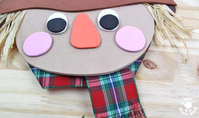 Step 10 - FOAM SCARECROW CRAFT - This cute foam scarecrow craft is great as a Fall craft or for harvest time and Thanksgiving. A free printable scarecrow template makes it super easy and fun to make.