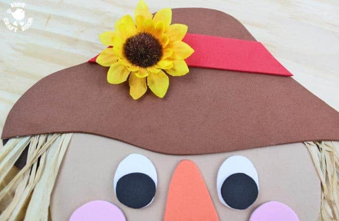 Step 11 - FOAM SCARECROW CRAFT - This cute foam scarecrow craft is great as a Fall craft or for harvest time and Thanksgiving. A free printable scarecrow template makes it super easy and fun to make.