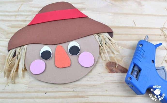 Step 7 - FOAM SCARECROW CRAFT - This cute foam scarecrow craft is great as a Fall craft or for harvest time and Thanksgiving. A free printable scarecrow template makes it super easy and fun to make.