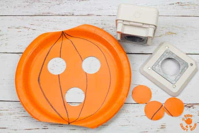 Paper Plate Pumpkin Lacing Craft Step 3